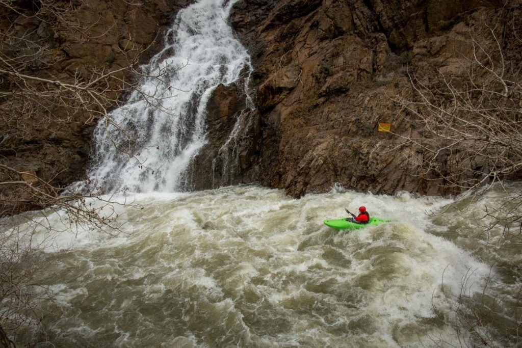 kayaker going over rapids on the Ogden River