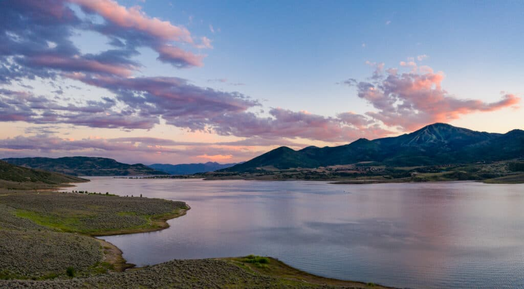 beautiful sunset view of the Jordanelle reservoir in Park City, Utah during summer